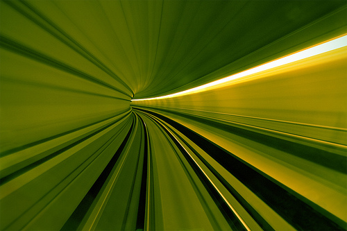 Blurred, mostly green lines forming a tunnel